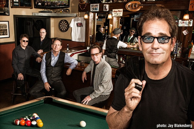 a recreation of the iconic album cover Sports, as recreated by Huey Lewis and the News in 2013